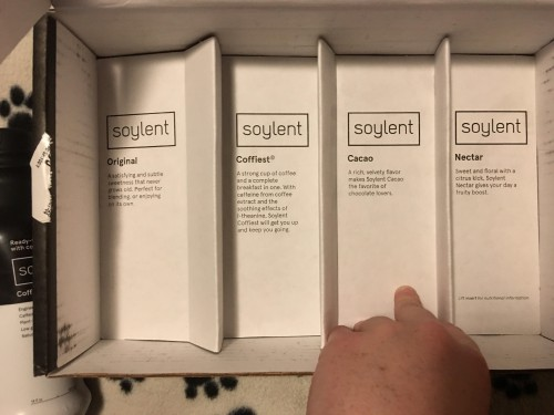 Here's the Soylent pack without the bottles, there's a little description under each slot! Excuse my weird looking hand, I had to hold the cardboard down as it didn't fit just right. :)